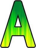 Green turning to yellow dripped paint background.  Free lettering sets for classroom display, crafts and scrapbooking.