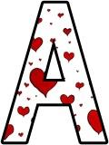 Free printable display lettering sets with a heart background.  Great for Valentines day displays.